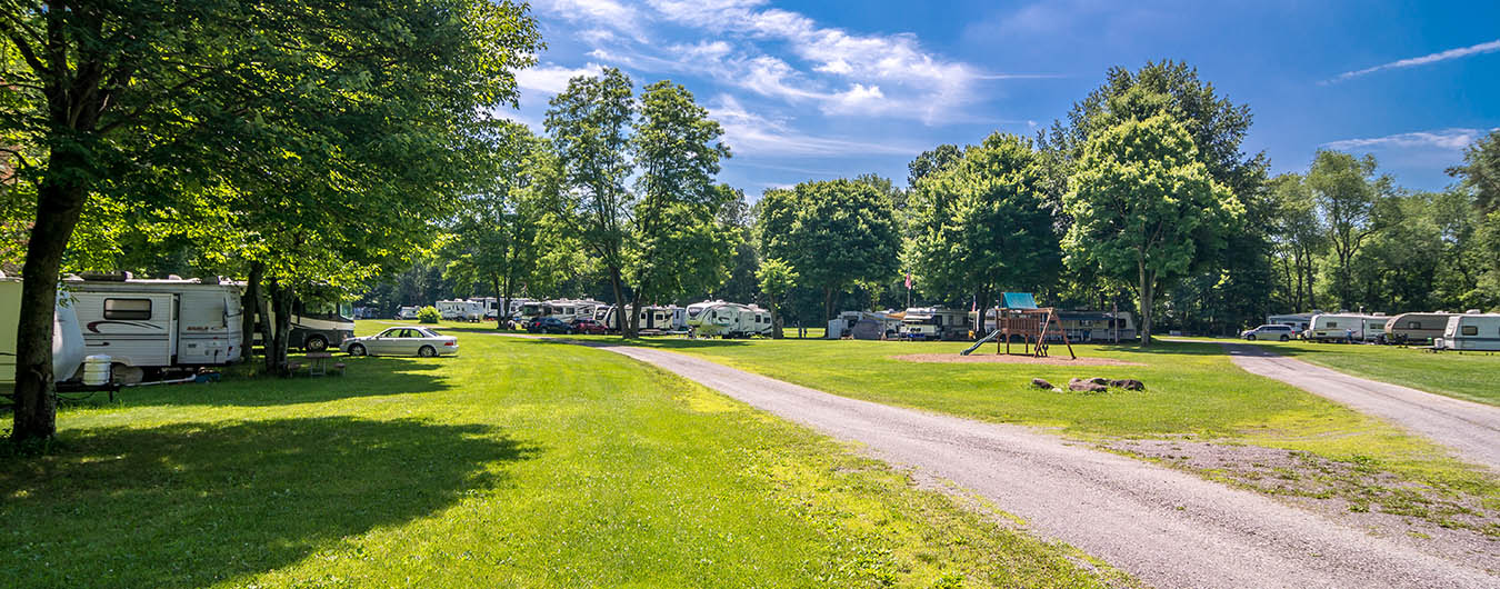 photo of campground with trailers in the background