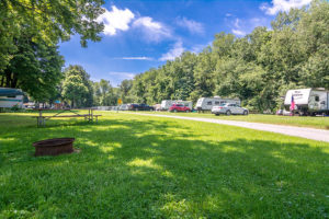 rv sites with trailers under the trees