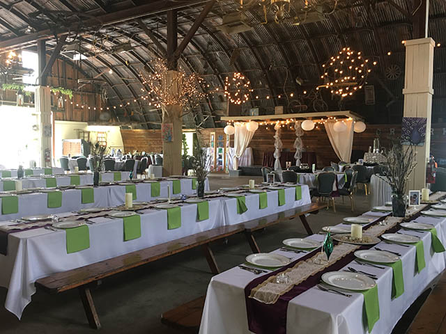 tables set with white tablecloths at the barn at chestnut ridge